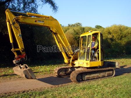 escavatore giallo uomo catene schaufelbagger raupenbagger