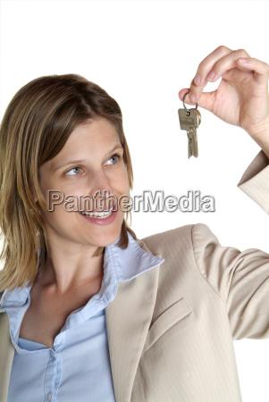 woman showing key