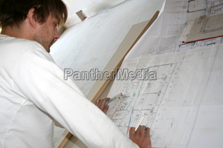 workers looking at construction drawing