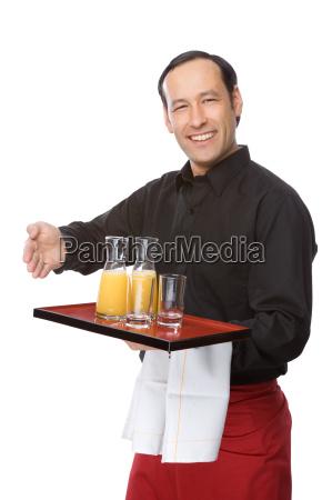 cameriere servito succo darancia
