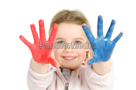 toddler with finger paints