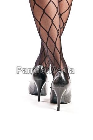 gambe femminili in collant e scarpe