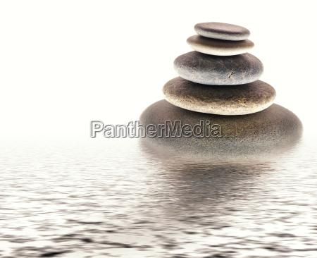 equilibrio armonia ciottolo zen acqua