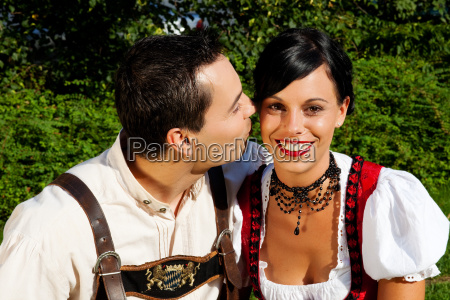 couple in costume dirndl and