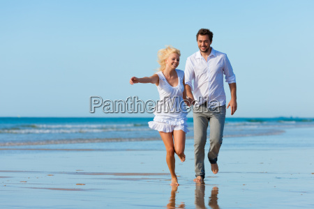 couple on the beach in summer