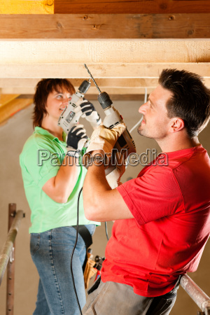 couple doing home improvement and expansion
