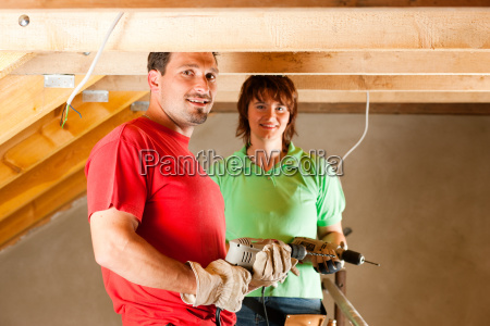 couple at home improvement and expansion
