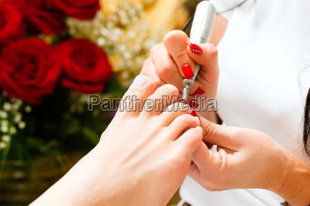woman in cosmetic studio getting pedicure