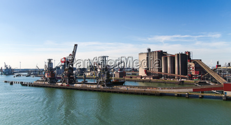grain elevator in harbour with terminal