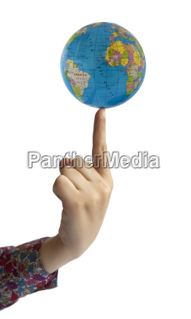 hand holding globe on finger
