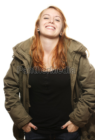 laughing young red haired woman wearing