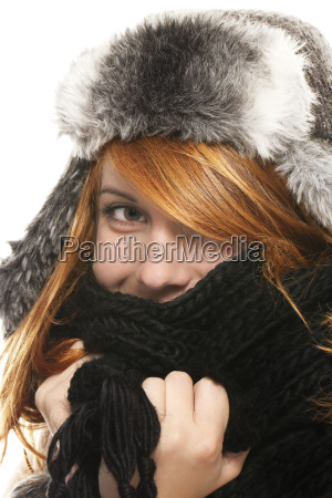 a young red haired woman hiding