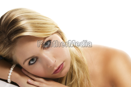 beautiful blonde woman lying with her