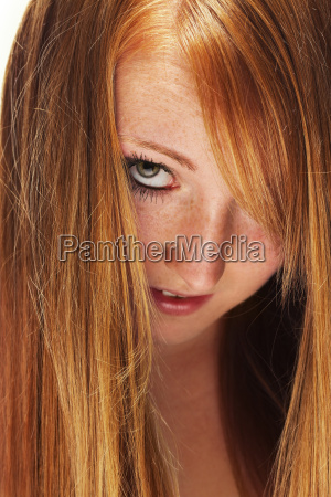 young redhead woman looks through her