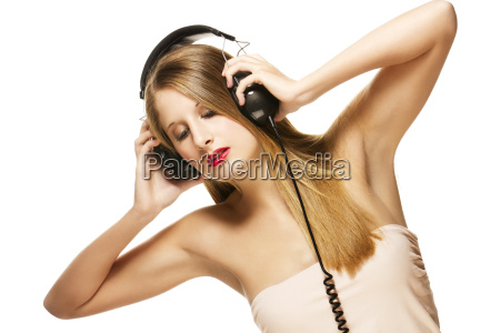 beautiful woman listening to music with