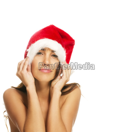 young woman with santa hat pulls
