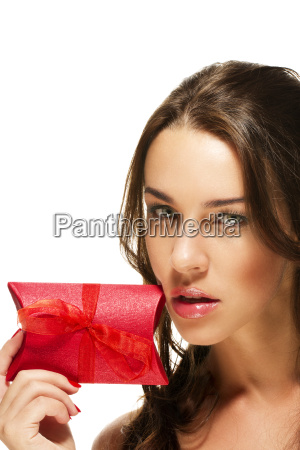 beautiful woman holds red gift to