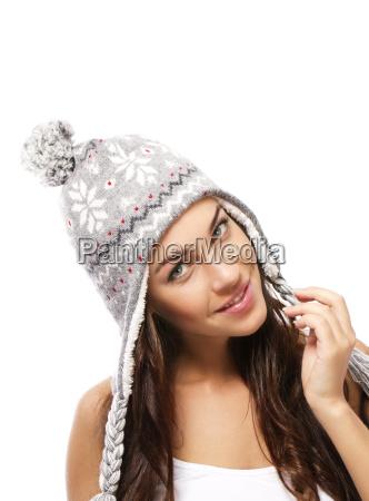 beautiful smiling woman wearing winter cap