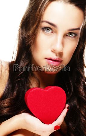 beautiful woman holding small red heart