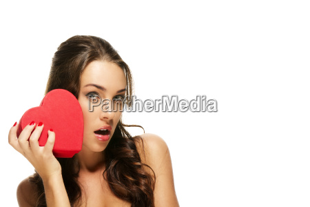 beautiful brunette woman holding red heart