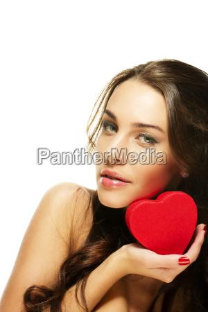 beautiful brunette woman holding red heart