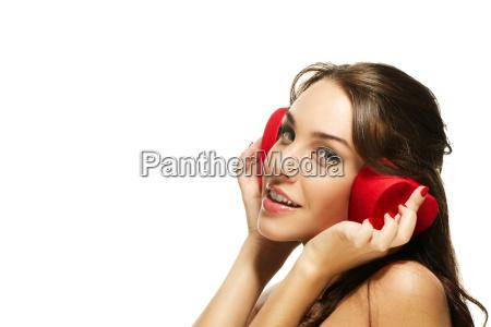 beautiful woman holding heart shaped box