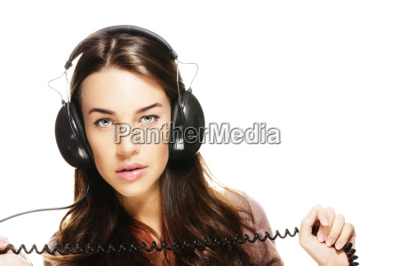 young woman listens to music and