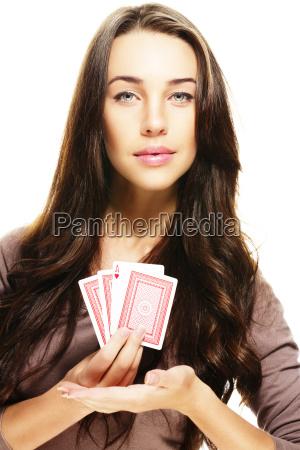 beautiful woman presents poker cards