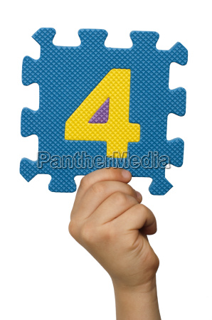 children hand holding the number four