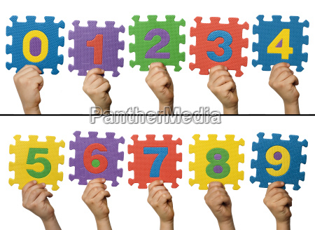 children hands holding numbers white isolated