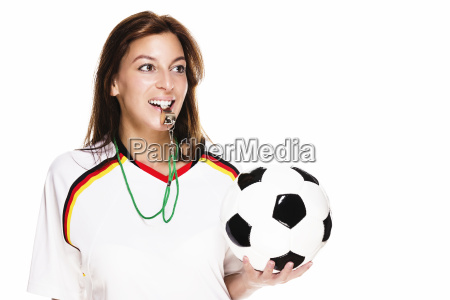 happy woman with whistle wearing jersey
