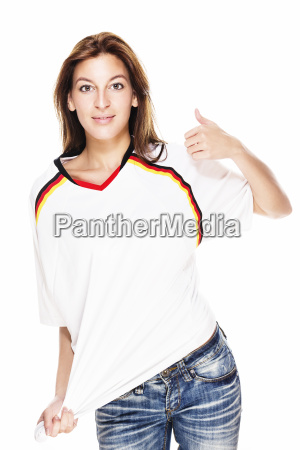 smiling young woman wearing football jersey