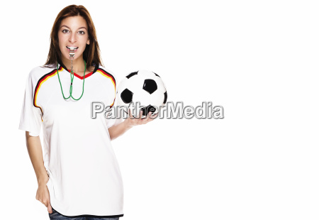 young woman with whistle wearing football