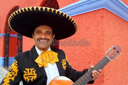 charro mariachi playing guitar case messico