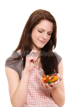 eat young smiling woman eating salad