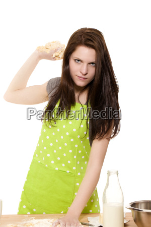 angry young woman will throw dough