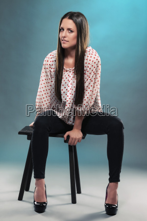 pretty young woman on a stool