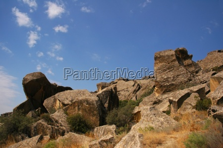 scenery with rocks and blue clear