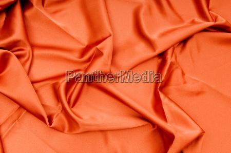 tessuto di raso brillante piegato da