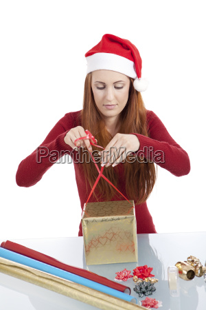 young woman is packing presents for
