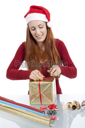 young woman packing presents for christmas