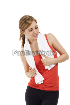 young sportswoman with towel looking to