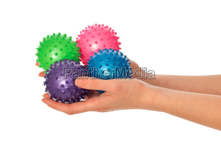 quattro palle da massaggio colorate