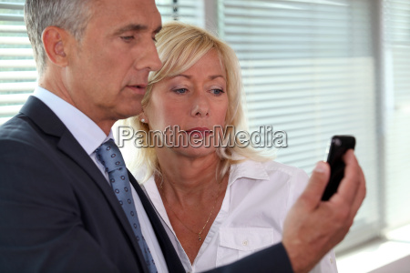 mature businessman showing his blonde wife