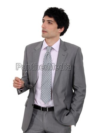 a businessman looking in the distance