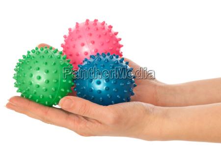 tre sfere di massaggio colorate