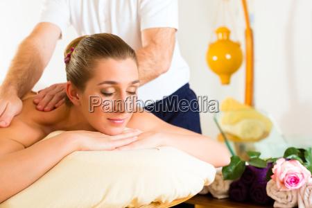 woman gets a massage spa