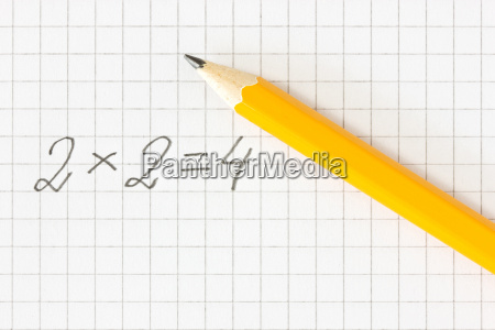 math formula and pencil on squared