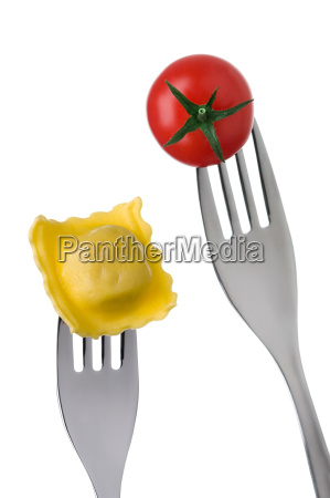 ravioli and tomato on forks