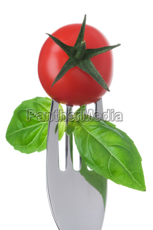 tomato and basil on a fork